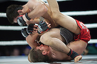 Moscow, Russia, 05/06/2010..Rasul Mirzaev punches a bloodied Marat Peksov in the face in a mix-fight bout during the new Fight Nights boxing tournament, featuring kick-boxing, boxing and mixed fighting.