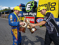 Jun 6, 2016; Epping , NH, USA; NHRA funny car driver Ron Capps (left) celebrates with pro stock driver Greg Anderson after winning the New England Nationals at New England Dragway. Mandatory Credit: Mark J. Rebilas-USA TODAY Sports