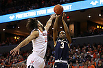 02 January 2016: Notre Dame's V.J. Beachem (3) shoots over Virginia's Anthony Gill (13). The University of Virginia Cavaliers hosted the University of Notre Dame Fighting Irish at the John Paul Jones Arena in Charlottesville, Virginia in a 2015-16 NCAA Division I Men's Basketball game. Virginia won the game 77-66.