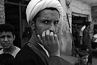 Baghdad, Iraq, June 13, 2003.Unidentified young Shia'i cleric in ex- Saddam city, now called Medina Al Sadr in memory of Imam Al Sadr who was killed in 1999 by Saddam Hussein