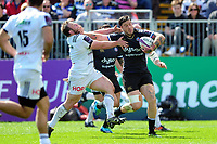 Matt Banahan of Bath Rugby fends Vivien Devisme of Brive. European Rugby Challenge Cup Quarter Final, between Bath Rugby and CA Brive on April 1, 2017 at the Recreation Ground in Bath, England. Photo by: Patrick Khachfe / Onside Images