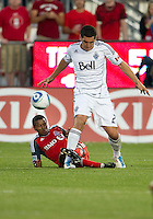 Vancouver Whitecaps FC defender Michael Boxall #2 and Toronto FC defender Danleigh Borman #25 in action during an MLS game between the Vancouver Whitecaps FC and the Toronto FC at BMO Field in Toronto on June 29, 2011..Toronto FC won 1-0..
