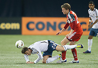 07 March 2012: LA Galaxy midfielder David Beckham #23 and Toronto FC midfielder Terry Dunfield #23 in action during a CONCACAF Champions League game between the LA Galaxy and Toronto FC at the Rogers Centre in Toronto.