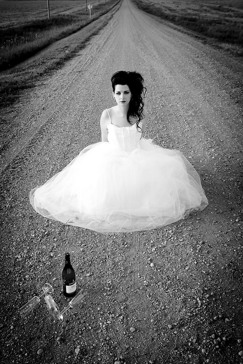 Manitoba bride photographed by Brian Milne on a gravel country road.