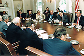 United States President Ronald Reagan meets with Soviet Foreign Minister Eduard Shevardnadze and other members of the Soviet delegation in the Cabinet Room of the White House in Washington, D.C. on September 15, 2014.  Seated across from the President, from left, Yuriy Dubinin, Ambassador to the U.S.; Foreign Minister Shevardnadze; Viktor Karpov, Soviet Ambassador at Large; and Gennadi Gerasimov, Soviet Spokesman.  Seated on the President's side of the table, from left, are: Kenneth Adelman, Director, U.S. Arms Control and Disarmament Agency; Jack Matlock, Ambassador to the U.S.S.R.; Ambassador Rozanne Ridgeway; U.S. Secretary of State George Schultz; the President; and U.S. Vice President George H.W. Bush.<br /> Mandatory Credit: Bill Fitz-Patrick / White House via CNP