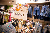 Back to school display is seen in an H&M department store in New York on Sunday, August 1, 2010. Stores are beginning to offer earlier than usual back to school specials. (© Richard B. Levine)