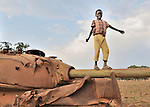 A boy plays on a tank, a remnant of recent war in Yei, a town in Central Equatoria State in Southern Sudan.
