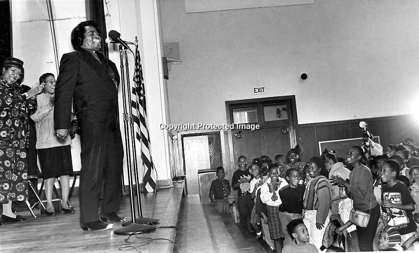 Soul singer James Brown entertains a group of school children in Oakland, Ca (1992 photo/Ron Riesterer)