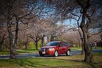 Red Dodge Caliber in Potomac park near Tidal basin D.C. during Cherry Blossom festival