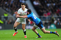 Henry Slade of England is tackled by Carlo Canna of Italy. RBS Six Nations match between England and Italy on February 26, 2017 at Twickenham Stadium in London, England. Photo by: Patrick Khachfe / Onside Images