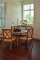 A sunlight filled breakfast nook is enhanced by the lighter wood finished and leather<br /> chairs with classic hardware details