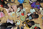 Meal time in an orphan care program sponsored by the Presbyterian Church in Kavuzi, Malawi. Many of the children have been orphaned by AIDS and related diseases.