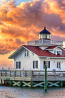 Sunrise and clouds at Roanoke Marshes Lighthouse on Shallow Bag Bay in Manteo North Carolina.