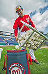 22 February 2013: Washington Nationals' bullpen catcher Octavio Martinez returns the practice balls after a full squad Spring Training workout at Space Coast Stadium in Viera, Florida. Mandatory Credit: Ed Wolfstein Photo *** RAW File Available ***