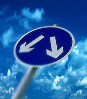 Road sign showing a fork in road to make a decision.