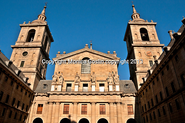 El Escorial is a historical residence of the kind of Spain and serves as a royal palace, museum, school and monastery that date back to the 16th and 17th centuries. Featured here is the facade of the Basilica of San Lorenzo el Real