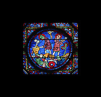 Detail of Roland, shown twice, attempting to break his sword (left) and blowing his horn (right), the Charlemagne Window, ambulatory, early 13th century, Chartres Cathedral, Eure et Loir, France Picture by Manuel Cohen