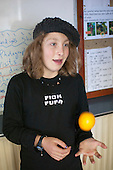 One of the young students tossing an orange, Summerhill School, Leiston, Suffolk. The school was founded by A.S.Neill in 1921 and is run on democratic lines with each person, adult or child, having an equal say.  You don't have to go to lessons if you don't want to but could play all day.  It gets above average GCSE exam results.