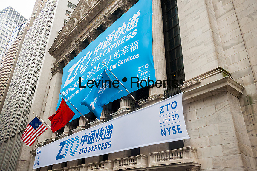 The New York Stock Exchange is decorated for the first day of trading for the ZTO Express IPO on Thursday, October 27, 2016. The initial public offering of the Chinese package delivery service is the largest IPO by a Chinese company since the Alibaba IPO in 2014. 72.1 million shares were priced at $19.50 per share. 75 percent of ZTO Express' business comes from Alibaba. (© Richard B. Levine)