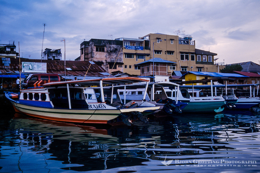 Indonesia, Sulawesi, Manado. Bunaken passenger boats in the harbour.