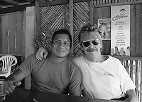 Photographer (yours truly) with Quichua guide Rawje having 'una cerveza' in small village of Chantpunta on the Rio Napo, Ecuador.