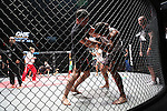Fighters in pre-fight sparing warm up in cage<br />