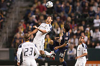 Omar Gonzalez (4) of the LA Galaxy with a headball. The LA Galaxy defeated the Philadelphia Union 1-0 at Home Depot Center stadium in Carson, California on  April  2, 2011....