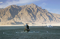 Helicopters on landing pad in Hunza region of Karokoram Mountains, Pakistan