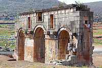 Arch of Mettius Modestus, built c. 100 AD to celebrate the completion of an aqueduct to bring water to the city, Patara, Antalya, Turkey. This triple-vaulted triumphal arch is composed of 4 massive piers connected by 3 arches. It functioned as the final part of the aqueduct built by Trebonius Proculus Mettius Modestus, governor under the emperor Trajan. It was originally decorated with statues of him and his family on the twelve projecting consoles. Patara was a maritime Greek and Roman city on the South West Mediterranean coast of Lycia near modern-day Gelemis. It was said to be founded by Patarus, son of Apollo, and was famous for its temple and oracle of Apollo. It was a leading city of the Lycian League. Picture by Manuel Cohen