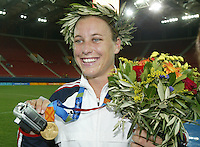 26 August 2004: Abby Wambach smiles with her gold medal after she scored a game-winning goal in overtime against Brazil at Karaiskaki Stadium in Athens, Greece.   USA defeated Brazil, 2-1 in overtime.   Credit: Michael Pimentel / ISI.