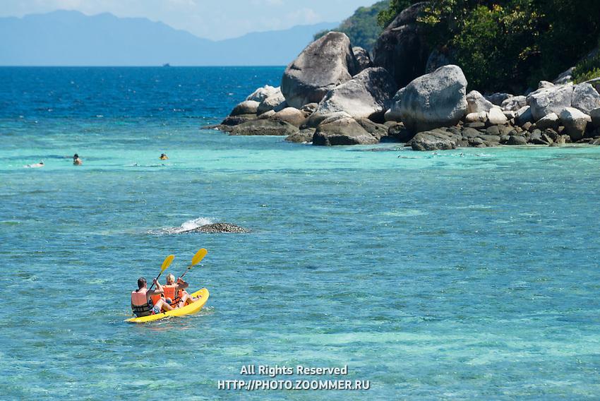 Family with two kids kayaking in Andaman sea, Ko Lipe, Thailand