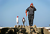 Wrapped up to protect himself from the sun above and the reflection below Jesus Luna, an employee for Quality Enterprises Inc., right, balances while walking a tape measure back from the beach along the rebuilt undercarriage of a board walk destroyed last summer by a series of hurricanes at Lovers Key/Carl E. Johnson State Park in Bonita Springs Thursday.  Reconstruction of the board walk started in June and is predicted to be finished some time at the end of August. Erik Kellar/Staff