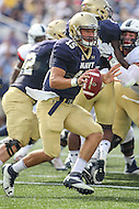 Annapolis, MD - September 9, 2016: Navy Midshipmen quarterback Will Worth (15) attempts to pitch the ball during game between UConn and Navy at  Navy-Marine Corps Memorial Stadium in Annapolis, MD. September 9, 2016.  (Photo by Elliott Brown/Media Images International)