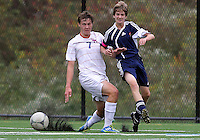 HYATTSVILLE, MD - OCTOBER 26, 2012:  Christian Cooke (7)  tackles Sam Danello (13) of DeMatha Catholic High School of St. Albans during a match at Heurich Field in Hyattsville, MD. on October 26. DeMatha won 2-0.