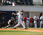 Ole Miss' David Phillips hits a home run vs. Oakland University in Oxford, Miss. on Sunday, February 28, 2010. Oakland catcher is John Estes.