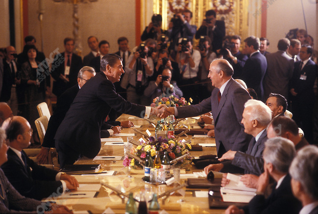 Ronald Reagan shakes hands with Mikhail Gorbachev during their second meeting at the Moscow summit, Moscow, Russia, May 1988