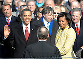 With his family by his side, Barack Obama is sworn in as the 44th president of the United States by Chief Justice of the United States John G. Roberts Jr. in Washington, D.C., Tuesday, January 20, 2009.  More than 5,000 men and women in uniform are providing military ceremonial support to the presidential inauguration, a tradition dating back to George Washington's 1789 inauguration. .Credit: Cecilio Ricardo - DoD via CNP.