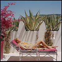 Liza Bruce sun-bathing on the roof terrace
