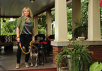 NWA Democrat-Gazette/ANDY SHUPE<br /> Amy White's favorite place is the front porch at her historic Fayetteville home which she shares with her dogs Harper (right) and Natalie. Tuesday, Aug. 18, 2015