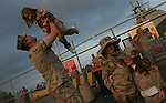 Marine Gunnery Seargeant Santiago Zapata lifts his 3-year-old daughter Vanessa into the air as the hour draws near for the departure of the 11th Marine Expedition Unit from the San Diego Naval Station aboard the ships of the 3rd Expeditionary Strike Group on a scheduled seven month deployment to Iraq. The 11th MEU - comprised of approximately 2,200 Marines - will arrive in Iraq in mid-July to replace elements of the 1st Armored Division which has been in Iraq for nearly a year-and-a-half.