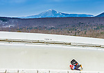 5 December 2014: Andi Langenhan, sliding for Germany, is thrown from his sled as he slides through Curve Number 14 on his first run, ending the day with non-finish in the Men's Competition at the Viessmann Luge World Cup, at the Olympic Sports Track in Lake Placid, New York, USA. Mandatory Credit: Ed Wolfstein Photo *** RAW (NEF) Image File Available ***