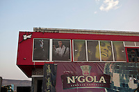 26 September 2011, Lubango, Angola. General street scenes of life in the Provincial capital. Michael Jackson, Elvis Presley and Bob Marley share display space on a theater in Lubango.