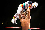 Lucha Libre AAA wrestler Deccnis prepares to bodyslam Mascarita Sagrada in San Jose, CA March 29, 2009.