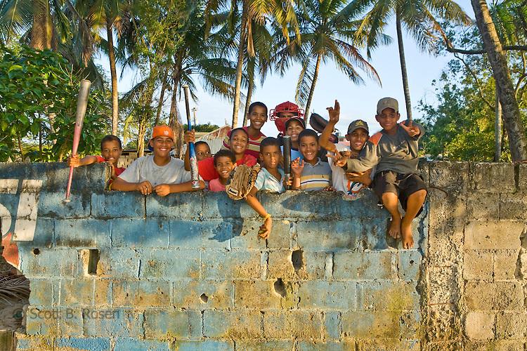 Future-hopeful Major Leauge baseball players practice near the beach in Rio San Juan, Dominican Republic