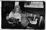 """April 1991:  Actress Donna Douglas, best  known for portraying Ellie May Clampett on """"The Beverly Hillbillies"""" TV show poses for a photos with some live chickens at a part at the Limelight nightclub in New York City."""