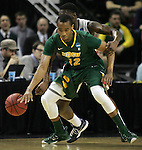 Gonzaga's Gary Bell (5) steals the ball from North Dakota State's Lawrence Alexander (12) during the 2015 NCAA Division I Men's Basketball Championship's March 20, 2015 at the Key Arena in Seattle, Washington.©2015. Jim Bryant Photo. ALL RIGHTS RESERVED.
