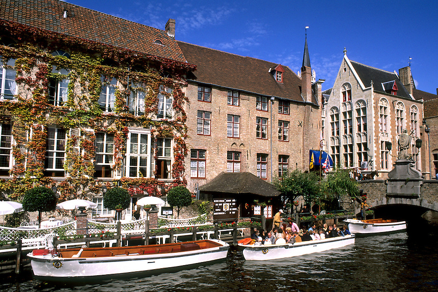 Belgium Houses and boats on Canals of beautiful Bruges Belgium