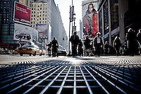 Sidewalk of 7th avenue, at the corner of 34th street in Midtown, Manhattan, New York, 2009.