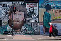 Belfast, Northern Ireland, United Kingdom, May 2011. Colourful murals with militaristic images are the silent reminders of the sectarian violence. During The Troubles, the Falls road area was prone to protestant loyalist attacks. For decades travellers stayed away from the sectarian violence, but since the end of'The Troubles' more and more people start discoving the beauty of Belfast and the Antrim Coast Causeway. Photo by Frits Meyst/Adventure4ever.com
