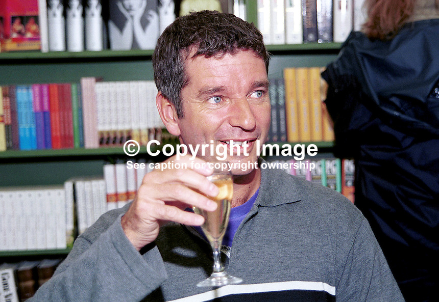 Tony Hawks, author, travel writer, comic, television personality, Britain, UK..Drinking champagne. Booksigning. Taken at or during Hay Festival. Ref: 200005034.<br />
